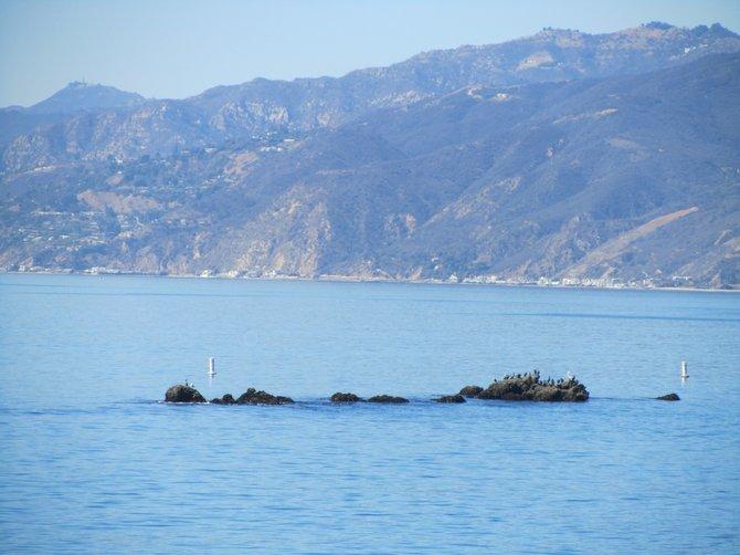 Malibu and the Pacific seen from Santa Monica Pier by: iolanda scripca