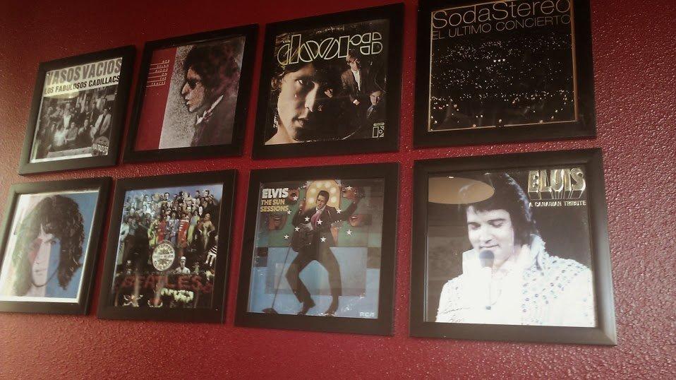 "Rock style at Memelas.  Note ""Los Fabulosos Cadillacs"" up there with Elvis et. al.!"