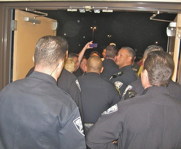 Six Chula Vista police officers and two private security officers showed up to vacate the room.