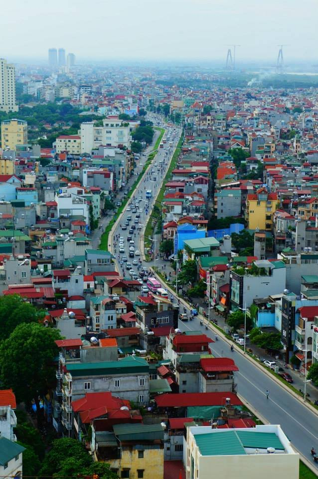 A slow time on a main highway through the center of Vietnam's capital city, viewed from the top of the Sofitel.