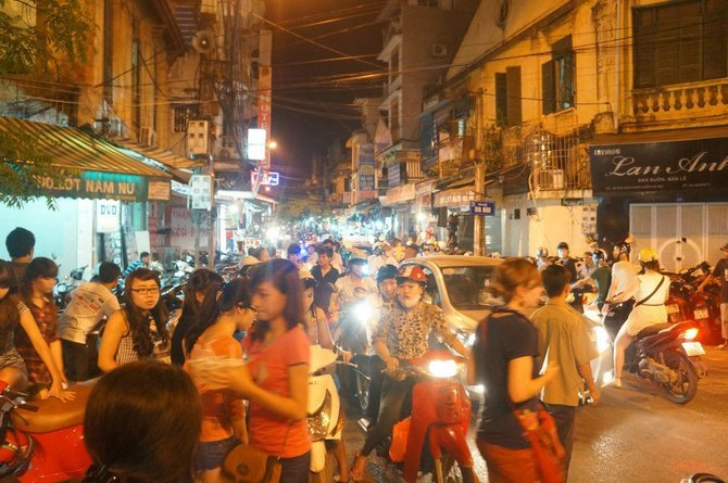 A typical night market in the Old Quarter of Hanoi. The streets become flooded with Viets and foreigners a like looking for tasty food and festive hand crafts.