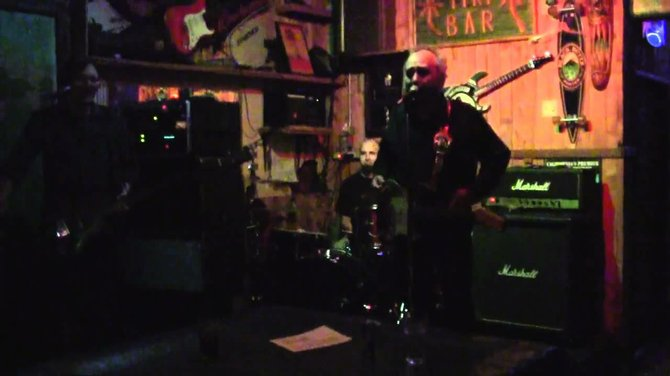 Joey Harris onstage at the Tiki House
