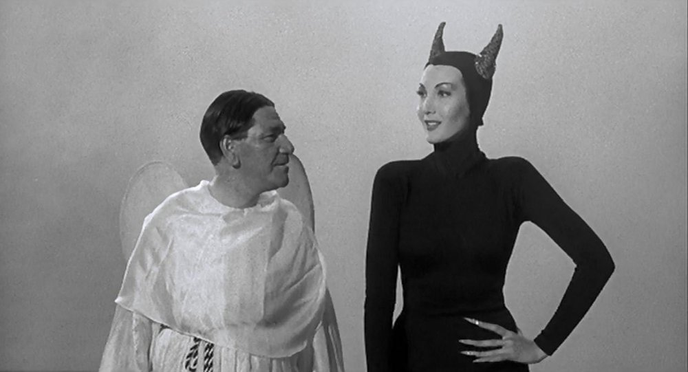 "Helen Blazes (Sylvia Lewis) welcomes Shemp Howard to hell in the Jules White shocker, ""Bedlam in Paradise."""