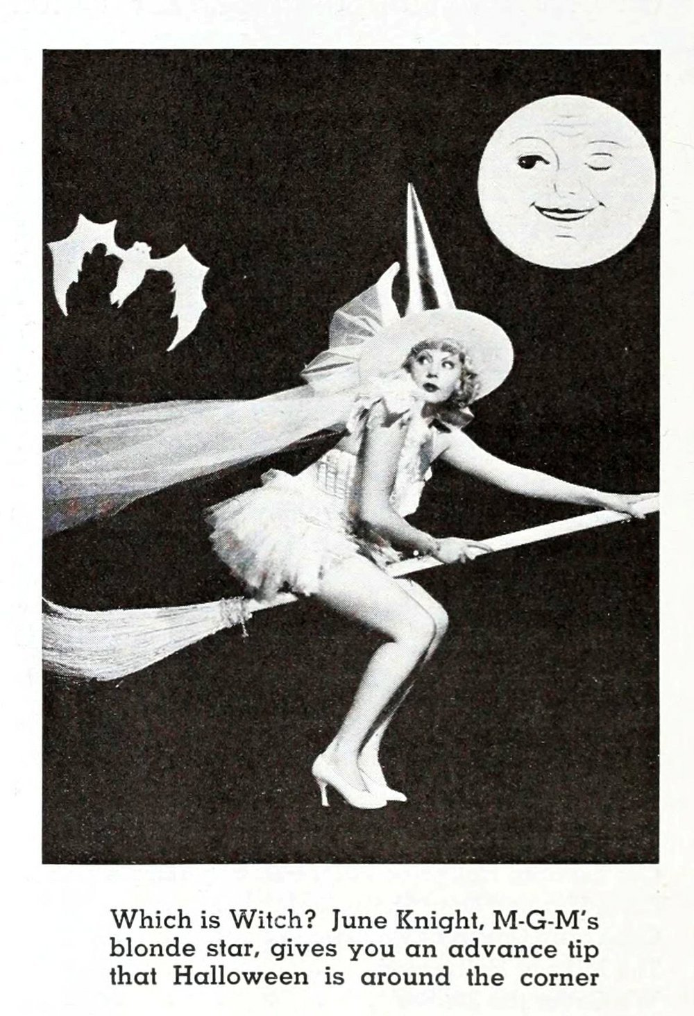 It's only a paper moon winking at the bewitching June Knight.