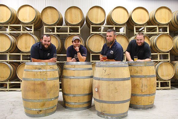 Societe Brewing: Tyler Tucker (assistant brewer), Doug Constantiner (founder/brewer), Travis Smith (founder/head brewer), Kevin Schmaltz (production assistant)