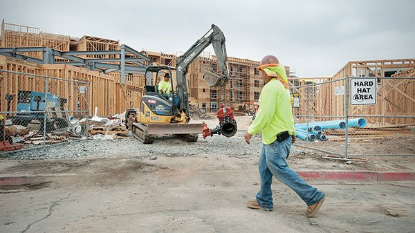 Workers are rushing to complete the 332-unit development before the 2014–2015 school year.