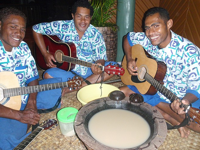 Fijians playing guitar at the kava ceremony.