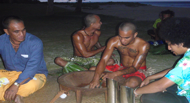 The kava-making process at work.