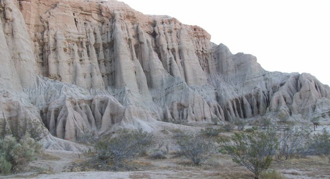 Towering mud cliffs, colorful sunsets and a hidden slot canyon await the adventurous en route to Las Vegas.