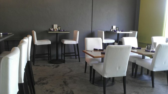 White chairs look attractive at Cafe Massilia, but will they weather years of customers' backsides and spilled coffees?