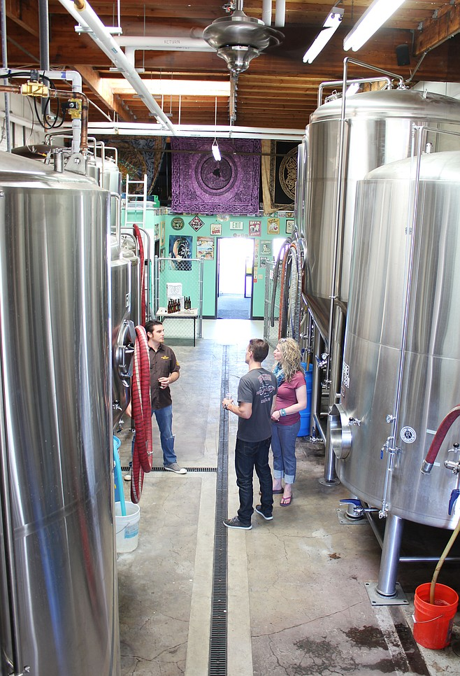 Mother Earth Brew Co.'s Kamron Khannakhjavani shows fans around the brewery during his company's open house event.