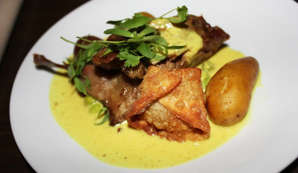 """South Park's Alchemy restaurant paired The Swindler with quail served with a pee wee potato, Thai yellow curry, and a quail egg """"purse."""""""