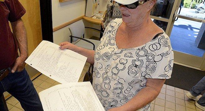 A burglary victim reviews her list of stolen items on November 9