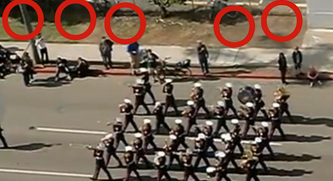 USMC Band parades down Pacific Highway; red circles indicate former campsites of homeless vets.