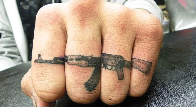 """""""I will admit,"""" Lowenstein writes, """"that I have not always been a responsible gun owner."""" (Tattoo by Nate Daugherty, Ukiah Tattoo Company)"""