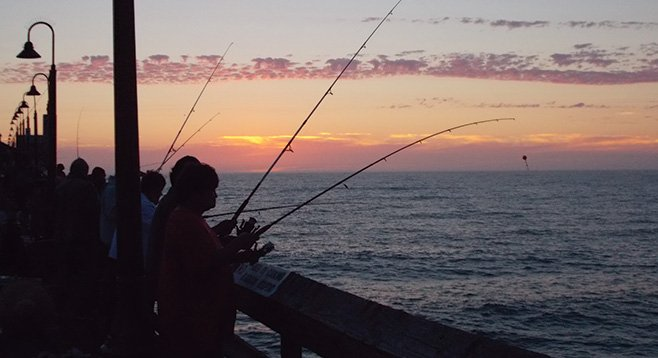 I.B.'s pier is all about fishing, especially at sunset.