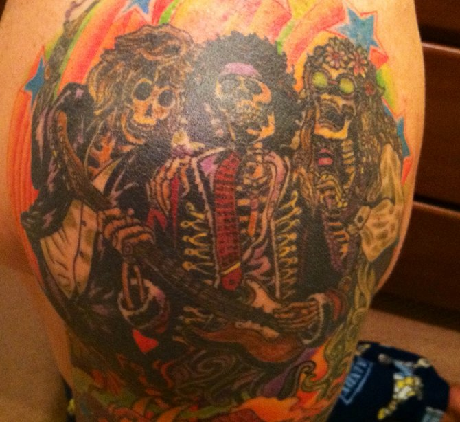 """My tattoo of Jim Morrison, Jimi Hendrix, and Janis Joplin. I love their music, and love the era of the 60's. This tattoo puts them together as the """"27 Club"""", having all died at the age of 27. I am 41 years old and live in Encinitas. I had it done at Saint Hillix Tattoo in North Park."""