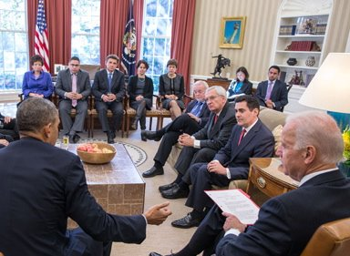 Solana Beach Presbyterian pastor Mike McClenahan (seated 3rd from left) attends immigration reform meeting with the President and Vice President.