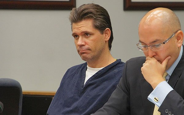 Kenny Lowary sits in court with his lawyer.