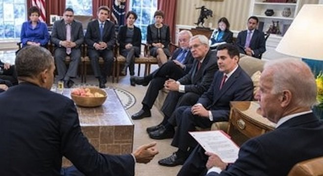 Solana Beach Presbyterian pastor Mike McClenahan (seated third from left, far side of room) at an immigration-reform meeting with the president and vice president.