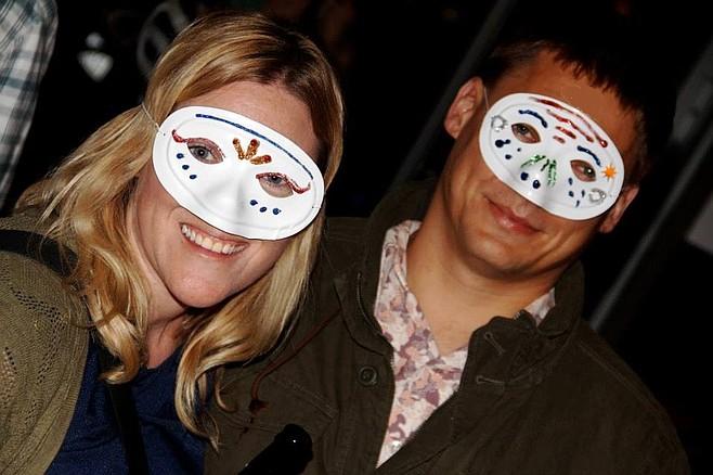 Siobhan and Aaron Braun wearing tragic DIY masks.