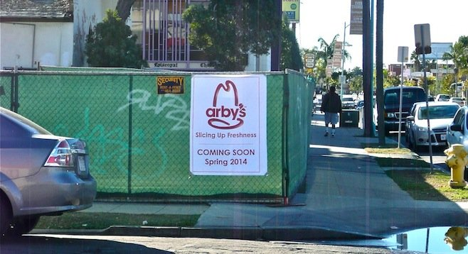 Construction fencing with Arby's sign (since removed)