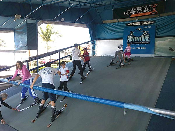 Novices learn to ski in the warmth of coastal North County at Adventure Ski and Snowboard School.