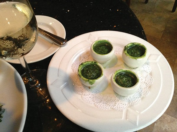 The snails, hiding in little white individual pots with a green parsley-ish garlic-and-herb sauce.