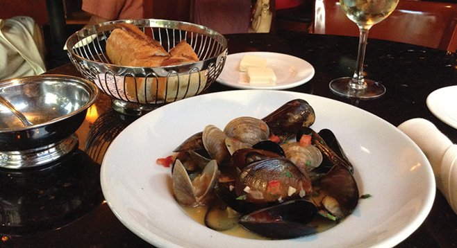 What $11 buys: 50/50 mix of mussels and clams, piece of bread, glass of house white.