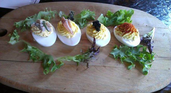 From right to left: Esplette, caviar, truffle and prosciutto, quail confit.