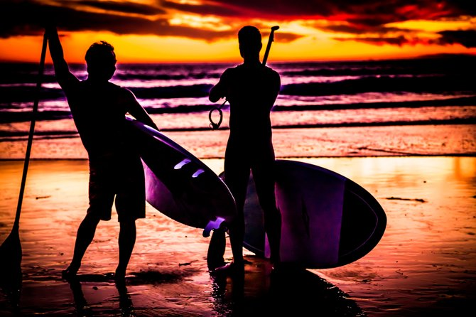 San Diego is all about the lifestyle: live it, breathe it, think it.  Get out there and take advantage!  Stand-up Paddlers sitting front row in Pacific Beach.