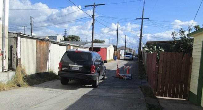 Unmarked vehicles blocked alley from both ends.