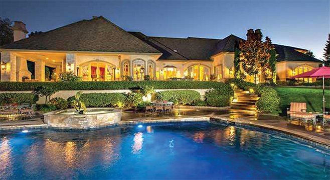 """The 1250-square-foot pool features """"hand-carved Italian stone lion head fountains."""""""