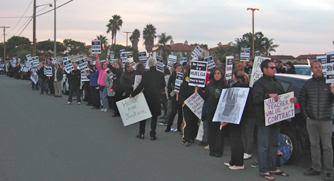 Teachers and supporters gathered outside the December 9 meeting