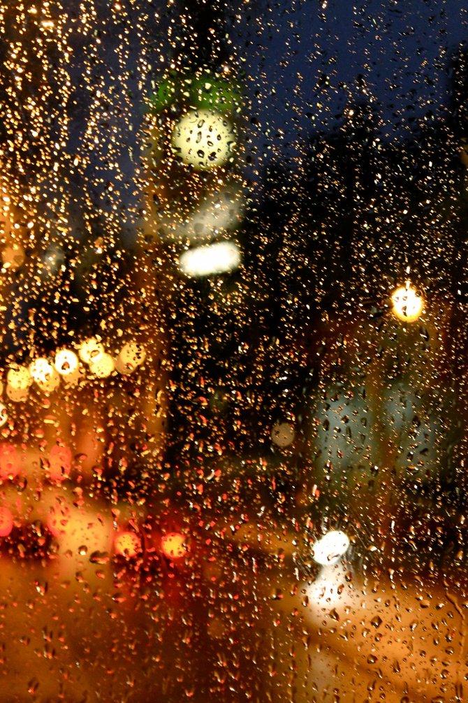 London's Big Ben through a rain-streaked window.