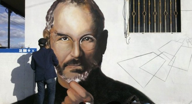 Buho works on recreating the Jobs portrait in mural form