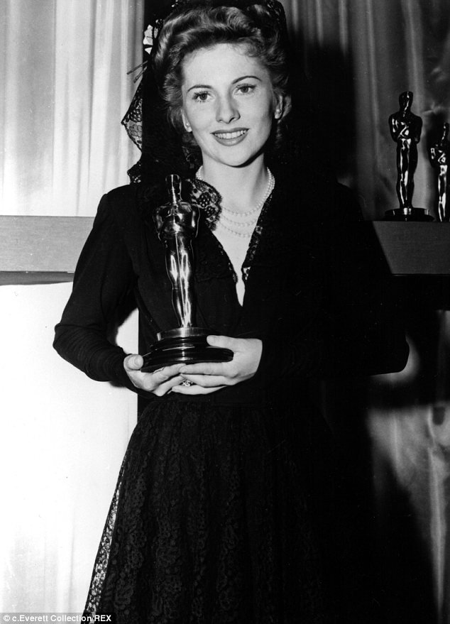 Joan Fontaine holds her Best Actress Oscar for Alfred Hitchcock's Suspicion.