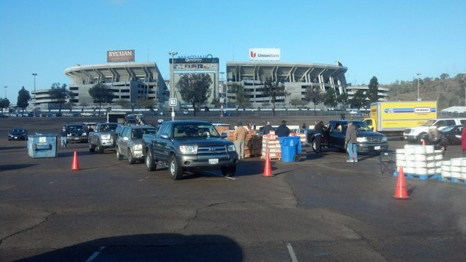 Volunteers distribute food among 500 cars outside Qualcomm Stadium