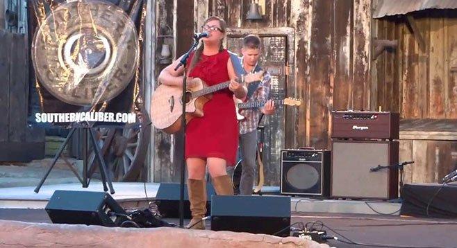 Suzanne Harper, bumped in San Diego, is celebrated in Nashville.