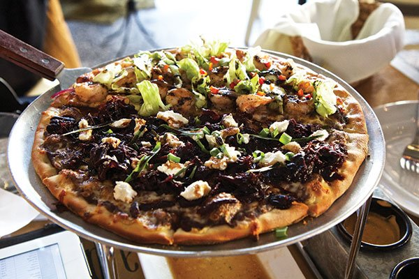 Some restaurants, such as El Colegio, are using pizza as a vehicle for Baja ingredients.