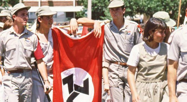 Youths carrying the Afrikaner Weerstandsbeweging (African Resistance Movement) flag during a right-wing rally in Klerksdorp in October 1993. Courtesy of The South African History Archive (SAHA).