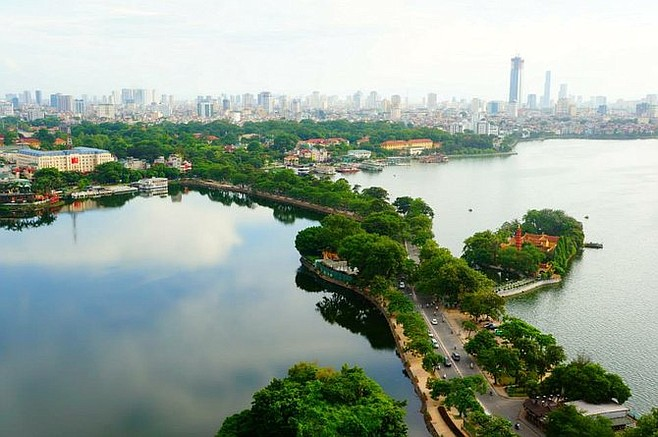 """A boulevard nicknamed """"the water bridge"""" that separates Hanoi's West Lake and Truc Bach Lake. In the evenings and weekends, the sidewalks are flooded with vendors selling food, balloons and even small animals."""