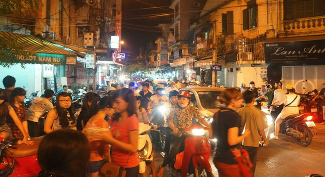A sampling of Vietnamese traffic near a night market in Hanoi's Old Quarter.