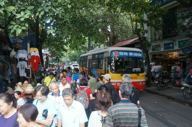 Everyone struggles for their space on the street – bus, motorbikes and pedestrians alike.