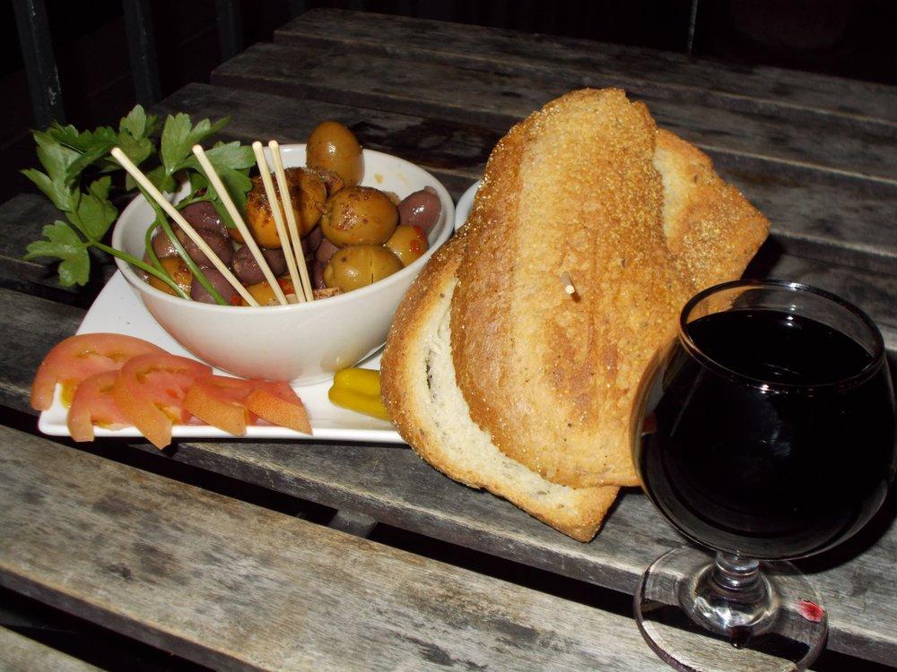 Olives, bread, port