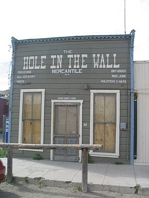 Hole in the Wall general store, with hitching post.