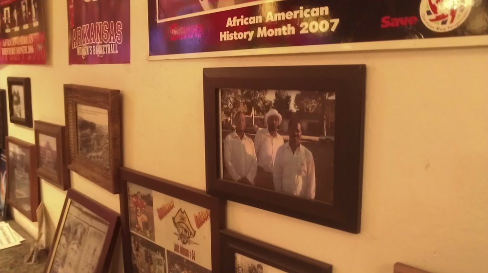Notable black figures on the wall at Barnes BBQ