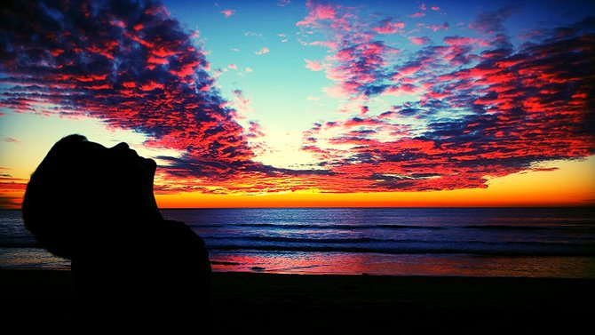 Moonlight beach in Encinitas w my son Hendrix gazing at the colorful sunset