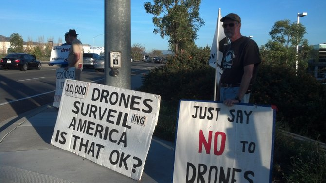 Dave Patterson, right, and other Veterans for Peace protest in Poway