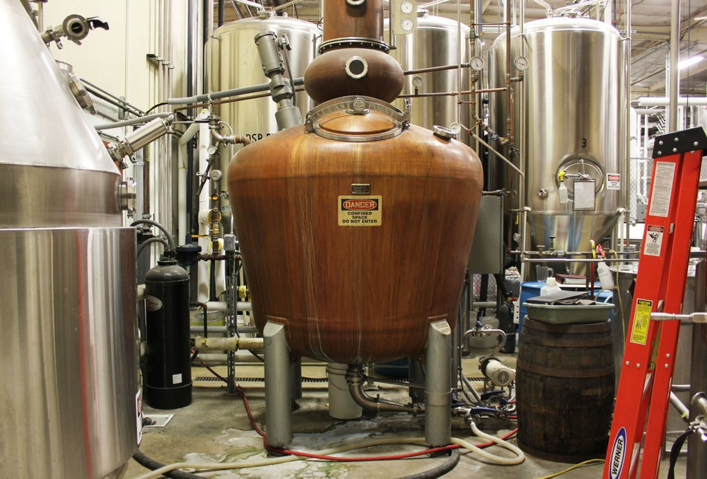 A view of Ballast Point Brewing & Spirits' copper still from the hallway leading to its new spirit tasting room